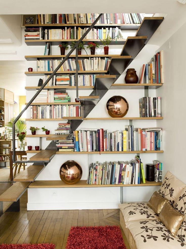 book shelf under stairs